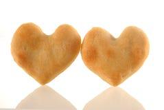 Ajouter de biscuits de coeur à la réflexion. Image libre de droits
