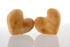 Ajouter de biscuits de coeur à la réflexion. Images libres de droits