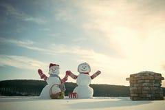 Ajouter de bonhomme de neige à la boîte actuelle Photographie stock libre de droits