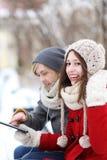 Ajouter de l'hiver à la tablette digitale Photographie stock