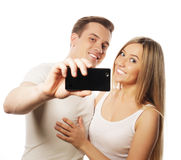 Ajouter de sourire au smartphone Image stock