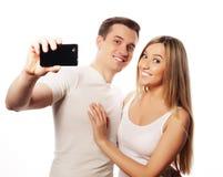 Ajouter de sourire au smartphone Photos stock