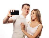 Ajouter de sourire au smartphone Photos libres de droits