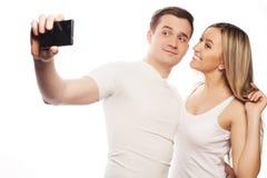Ajouter de sourire au smartphone Photo stock