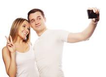 Ajouter de sourire au smartphone Photographie stock libre de droits