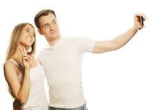 Ajouter de sourire au smartphone Images stock