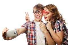 Ajouter de sourire au smartphone, au selfie et à l'amusement Image stock
