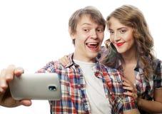 Ajouter de sourire au smartphone, au selfie et à l'amusement Photos stock