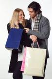 Ajouter de sourire aux sacs à provisions Photographie stock libre de droits