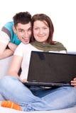 Ajouter heureux à l'ordinateur portatif Photographie stock libre de droits