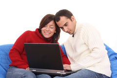 Ajouter heureux à l'ordinateur portatif Image stock