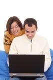 Ajouter heureux à l'ordinateur portatif Photos stock