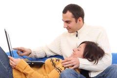 Ajouter heureux à l'ordinateur portatif Image libre de droits