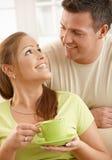 Ajouter heureux à la cuvette de thé Photo libre de droits