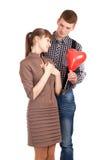 Ajouter heureux au ballon de forme de coeur Photo stock
