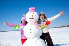 Ajouter heureux au bonhomme de neige Image libre de droits