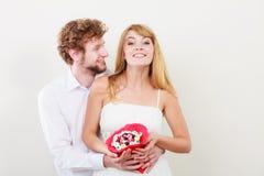 Ajouter heureux aux fleurs de groupe de sucrerie Amour Photo libre de droits