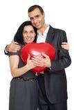 Ajouter romantiques au ballon dans la forme du coeur, de la belle femme et de l'homme d'isolement sur le fond blanc Photos stock