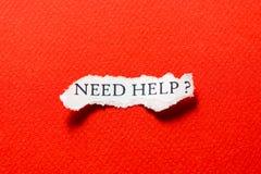 Ajuda da necessidade na sucata do vermelho do papel Imagens de Stock Royalty Free