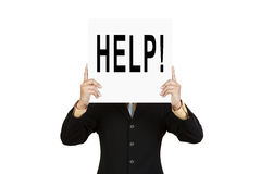 Ajuda do fraseio da mostra do homem de negócios na placa de papel Imagem de Stock