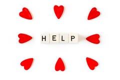 Ajuda e corações vermelhos Foto de Stock Royalty Free