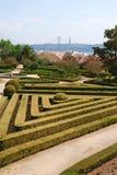 Ajuda Garten mit 25. April-Brücke in Lissabon Lizenzfreie Stockfotografie