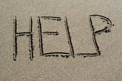 Ajuda na areia Fotografia de Stock