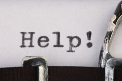 Ajuda na máquina de escrever velha Imagens de Stock Royalty Free