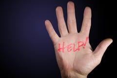 Ajuda na mão Fotografia de Stock Royalty Free