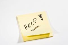 Ajuda pegajosa da nota Foto de Stock