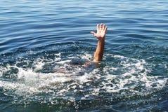 Ajuda! Vara da mão fora da água imagens de stock royalty free