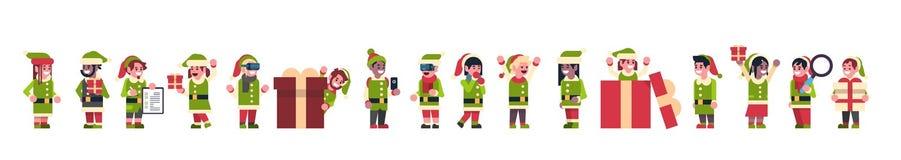 Ajudante de Papai Noel do menino da menina dos duendes da raça da mistura que está junto o conceito diferente do ano novo do feri ilustração stock