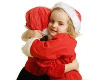 Ajudantes de Santa - hug Fotos de Stock Royalty Free