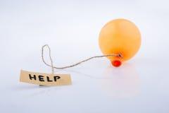 Ajude a exprimir o papel escrito unido a um balão ilustração do vetor