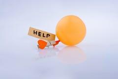 Ajude a exprimir, um coração e um balão fotografia de stock royalty free