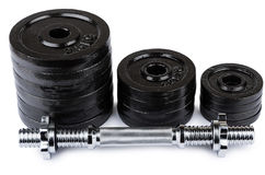 Ajustable dumbbell  and stack of disks isolated on white Stock Image