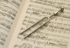 Ajustamento - forquilha e música Imagem de Stock Royalty Free