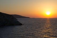 Ajuste bonito do sol/que aumenta sobre o horizonte de mar foto de stock