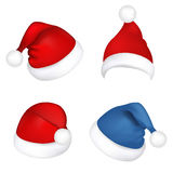 Ajuste chapéus de Papai Noel Imagem de Stock Royalty Free