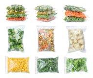 Ajuste com os vegetais congelados em uns sacos de plástico fotos de stock
