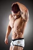 Ajuste considerável e homem muscular fotografia de stock
