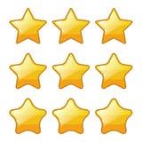 Ajuste da forma dourada da estrela para a classificação do jogo fotografia de stock