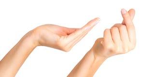 Ajuste da mão da mulher que guarda algo com dois dedos imagem de stock