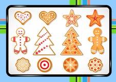 Ajuste das cookies bonitos do pão-de-espécie para o Natal em uma folha de cozimento ilustração do vetor