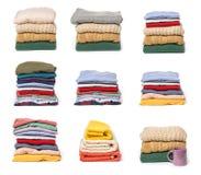 Ajuste das pilhas de roupa dobrada no fundo branco imagem de stock royalty free