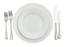 Ajuste de lugar com placa, a faca & a forquilha high-gloss. Fotos de Stock Royalty Free