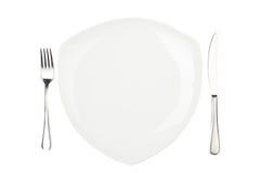 Ajuste de lugar com placa, a faca & a forquilha high-gloss. Imagens de Stock
