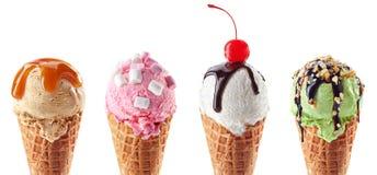 Ajuste de quatro várias colheres do gelado em cones do waffle fotografia de stock