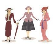 Ajuste de três mulheres na roupa do vintage do século XX ilustração stock