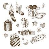 Ajuste dos brinquedos do Natal para crianças Peúgas para doces Presentes com fitas e coração Lua e estrelas tiradas mão, flocos d ilustração do vetor